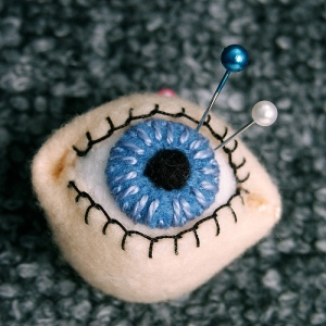 pin cushion eye