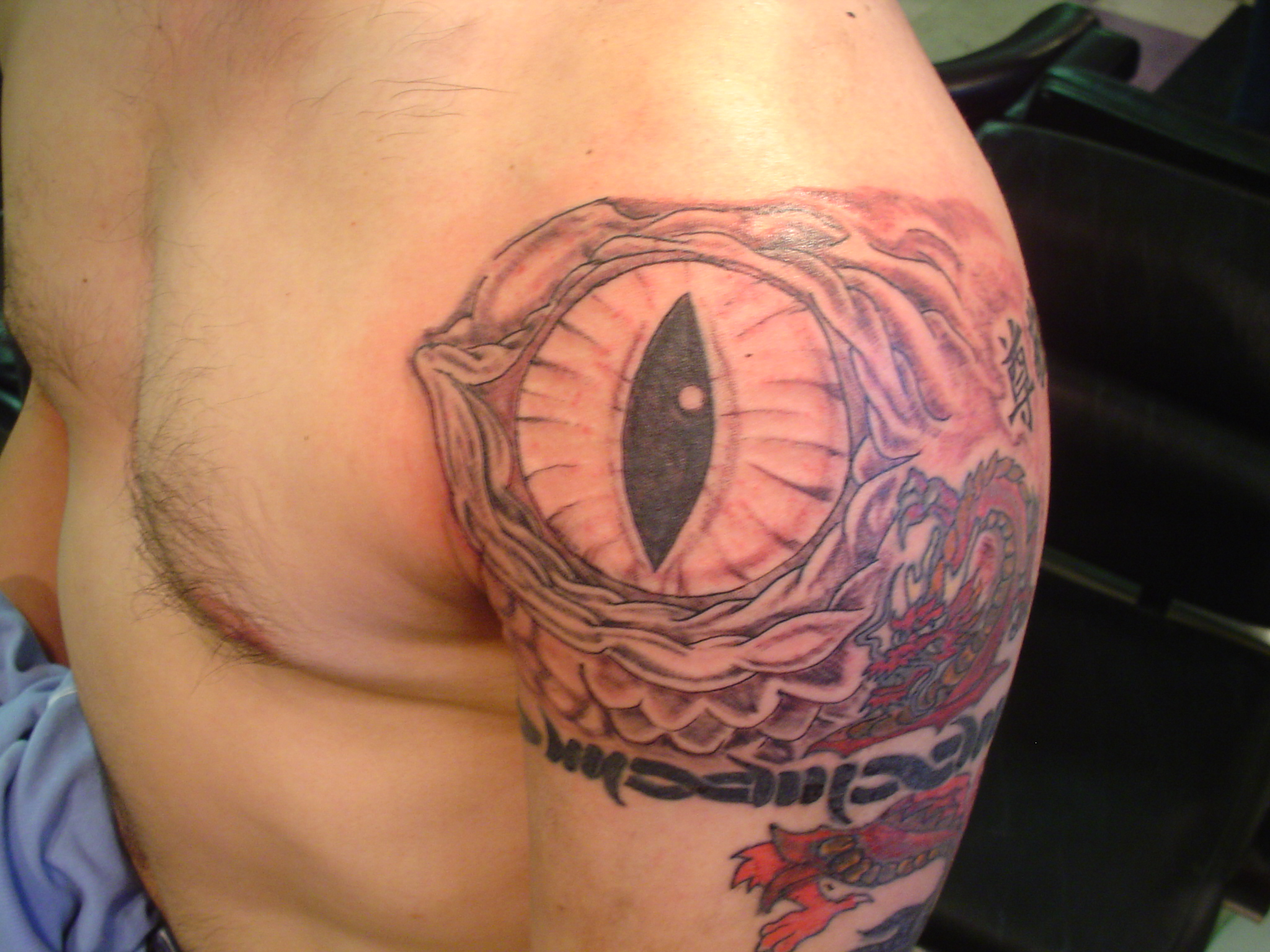 Tags: dragon, dragon eye ( 3 ), ink ( 3 ), shoulder, shoulder tattoo,