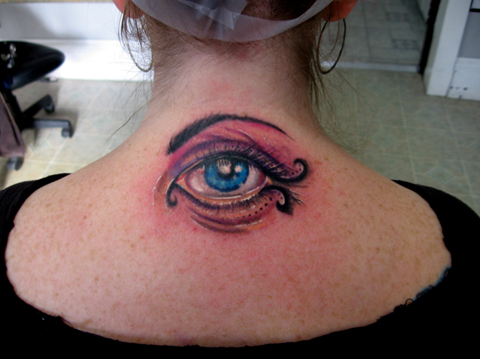 back of the neck eye tattoo