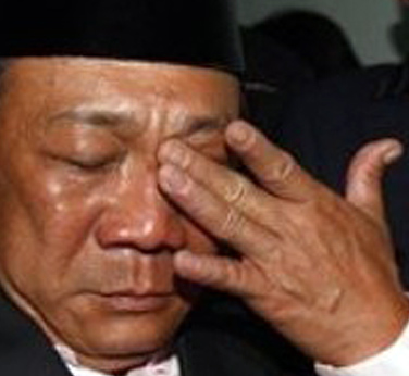 Bung Mokhtar Radin, left, wipes tears from his eyes